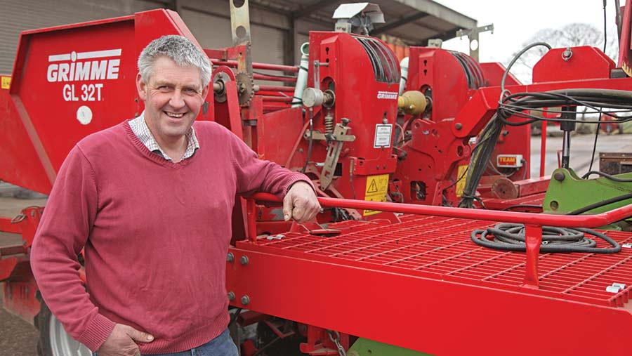 Adam Clarke in front of the Grimme GL32T