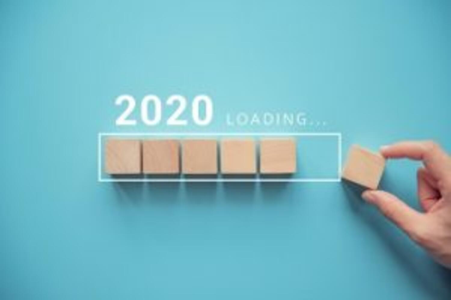 2020 loading with hand holding blank game board tiles