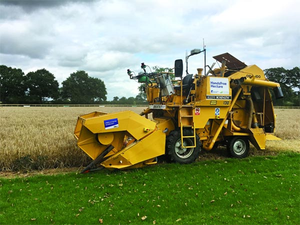 An autonomous harvester starts to cut robot-grown barley